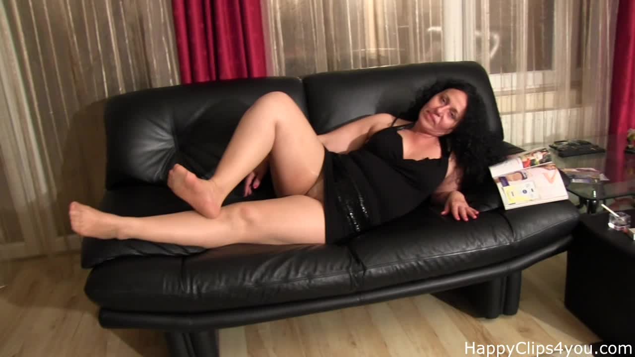 Foot fetish scene with smoking by older woman