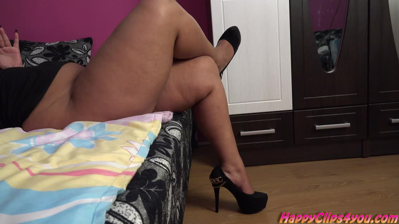 High heels dangling by Gina